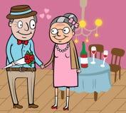 Het gelukkige oude paar viert Valentijnskaart Royalty-vrije Stock Foto's