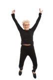 Het gelukkige oude vrouw springen. Royalty-vrije Stock Fotografie