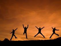Het gelukkige springen Stock Foto