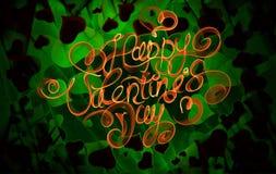 Het gelukkige Valentijnskaartendag uitstekende van letters voorzien geschreven door brand of oranje en groene rook over abstract  Royalty-vrije Stock Foto's