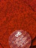 Het gelukkige Valentijnskaartendag uitstekende van letters voorzien geschreven door brand of rook over rood abstract hoogtepunt a Stock Afbeelding