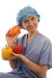 Het gelukkige verpleegster voedsel van artsen gezonde groenten Stock Afbeelding