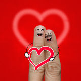 Het gelukkige vingerpaar in liefde met geschilderde smiley Royalty-vrije Stock Foto