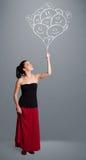 Het gelukkige vrouwenholding het glimlachen ballons trekken Royalty-vrije Stock Afbeeldingen