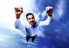 Het gelukkige zakenman vliegen Royalty-vrije Stock Afbeeldingen