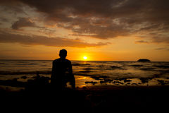 Het genieten van van zonsondergang Stock Foto's
