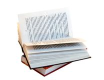 Het geopende boek boven op van ander boek stock fotografie