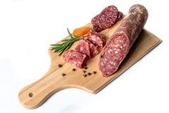 Het gerookte vlees op hout isoleerde witte achtergrond Stock Afbeeldingen