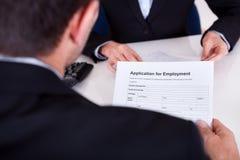 Het gesprek van de werkgelegenheid en aanvraagformulier Stock Afbeeldingen