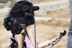 Het gesprek van TV Stock Foto