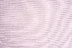 Het gestreepte roze breit stoffentextuur, gebreide patroonachtergrond stock foto