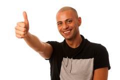 Het gesturing over omhoog geïsoleerde succes van de Handsom jonge mens met duim Royalty-vrije Stock Foto