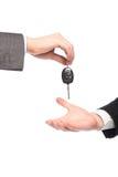Het geven van autosleutels Stock Afbeelding