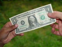 Het geven van dollar Stock Afbeeldingen
