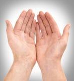 Het geven van Handen Stock Foto's
