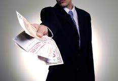 Het geven van het geld Stock Fotografie