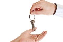 Het geven van sleutels Stock Fotografie
