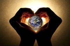 Het geven voor de aarde Stock Afbeelding