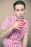 Het gevoelsjongen drinken royalty-vrije stock afbeelding