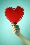 Het gevormde hart van de hand holding stock afbeelding