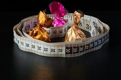 Het gewichtsverlies is uw keus slank taille of suikergoed royalty-vrije stock afbeeldingen
