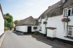 Het gezellig ouderwetse dorp van het land. Stock Foto