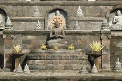 Het gezette standbeeld van Boedha in Bali, Indonesië Royalty-vrije Stock Afbeeldingen