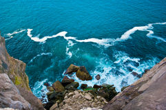 Het gezicht en de oceaan van de rots Royalty-vrije Stock Foto