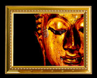 Het gezicht van Boedha in gouden kader Royalty-vrije Stock Foto's