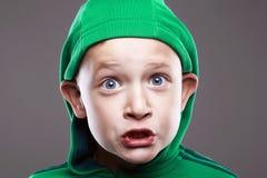 Het gezicht van de baby Grappige jongen in Kap royalty-vrije stock afbeelding