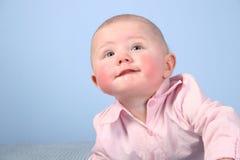 Het gezicht van de baby met rode wang Stock Foto