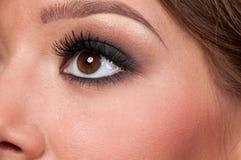 Het gezicht van de close-up van aantrekkingskrachtvrouw Stock Foto's