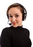 Het gezicht van de close-up van jonge vrouw in hoofdtelefoons royalty-vrije stock foto