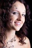 Het gezicht van de vrouw met het portret van de verfclose-up Stock Foto