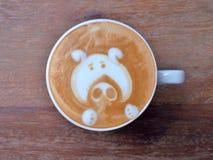 Het Gezicht van het de kunstvarken van de Lattekoffie stock foto's