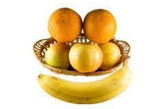Het gezicht van het fruit in mand Stock Afbeeldingen