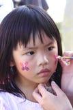 Het gezicht van het meisje het schilderen Royalty-vrije Stock Fotografie