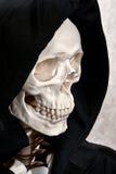 Het gezicht van het skelet in kap Stock Afbeelding