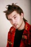 Het gezichts het te zware jonge mens van de acteur stellen voor Stock Fotografie