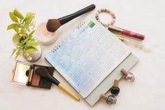 Het gezichts vastgesteld kosmetisch make-up en notitieboekje van de schoonheidshuid Royalty-vrije Stock Foto's