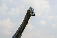 Het gezichtspunt van het dinosaurusstandbeeld in Phayao, Thailand Stock Foto