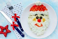 Het gezichtssalade van Kerstmissanta claus voor vakantiediner Royalty-vrije Stock Foto