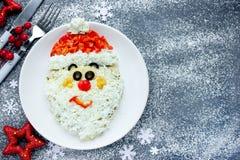 Het gezichtssalade van Kerstmissanta claus voor vakantiediner Royalty-vrije Stock Foto's