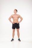 Het gezonde atletische mens stellen stock afbeeldingen
