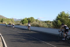 Het gezonde de oefening van de triatlon triathlete sport cirkelen Stock Foto's