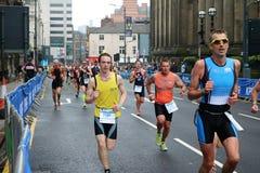 Het gezonde de oefening van de triatlon triathlete sport lopen Stock Afbeeldingen