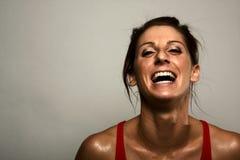 Het gezonde Lachen van de Vrouw van de Geschiktheid Stock Foto's