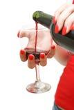 Het gieten van een Glas Wijn Royalty-vrije Stock Foto