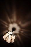 Het glanzen glans in dark Stock Afbeelding