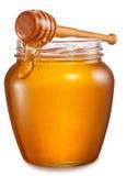 Het glas kan hoogtepunt van honing en houten stok op het royalty-vrije stock foto